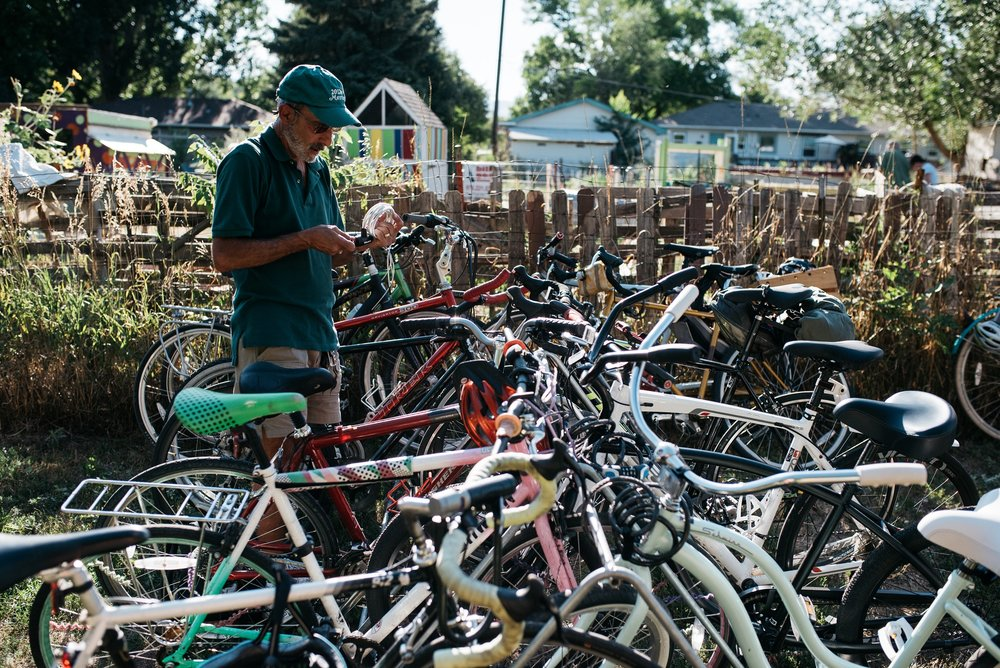 Bikes locked up at Mulberry Community Gardens during the Fortified Collaborations 3 Forks Progressive Farm Dinner. Event photography by Sonja Salzburg of Sonja K Photography.