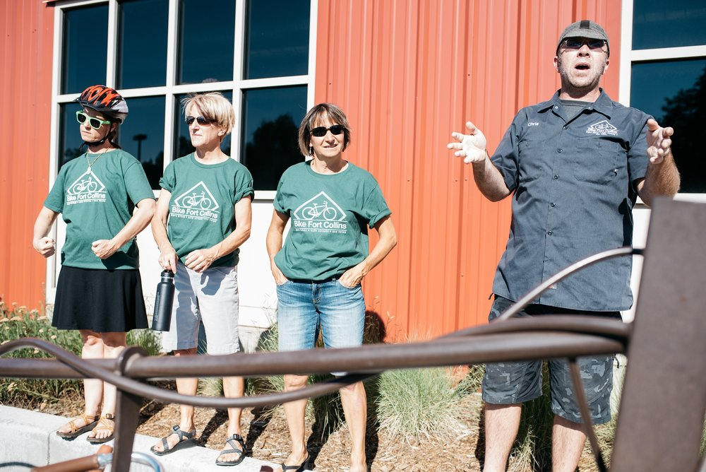 Volunteers from Bike Fort Collins get the crowd ready to ride at the 3 Forks Progressive Farm Dinner from Fortified Collaborations. Event photography by Sonja Salzburg of Sonja K Photography.