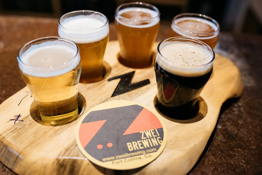 A wooden taster tray at Zwei Brewing in  Fort Collins, Colorado for their 2nd Anniversary party. Zwei Ist Zwei. Event photography by Sonja Salzburg of Sonja K Photography.