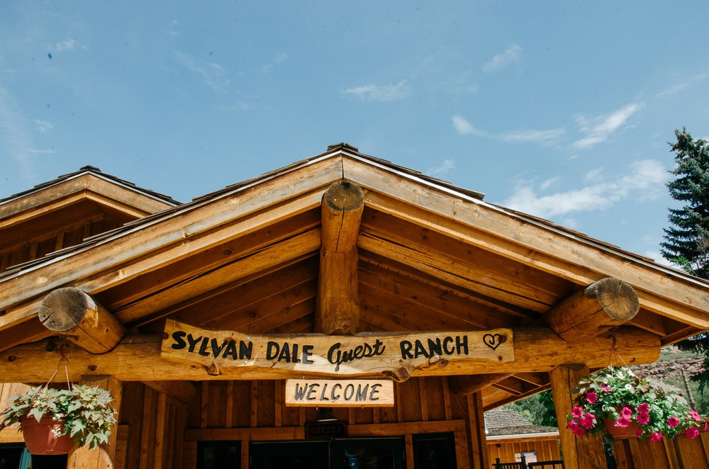 The entrance to the lodge at Sylvan Dale Guest Ranch outside of Loveland, Colorado. Wedding photography by Sonja Salzburg of Sonja K Photography.