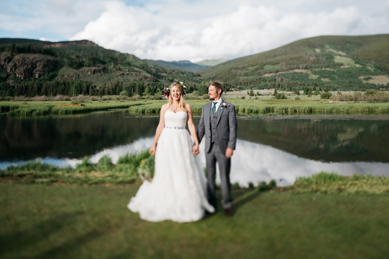 A bride and groom kiss on their wedding day at Camp Hale near Vail, Colorado. Wedding photography by Sonja Salzburg of Sonja K Photography.