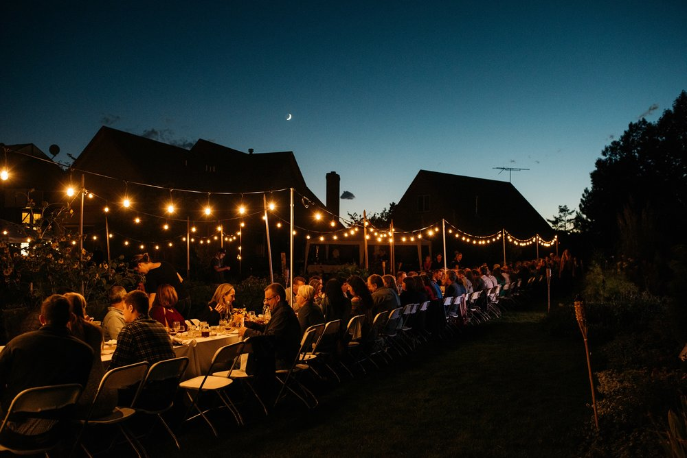 The moon rises over the Fortified Collaborations Mishawaka 100 Year Harvest Dinner at Grant Farms CSA outside Fort Collins, Colorado. Event photography by Sonja Salzburg of Sonja K Photography.