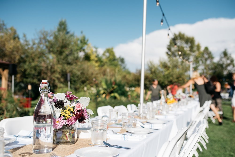 The table is set at the Fortified Collaborations Mishawaka 100 Year Harvest Dinner at Grant Farms CSA outside Fort Collins, Colorado. Event photography by Sonja Salzburg of Sonja K Photography.