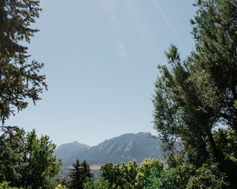 The Flatirons outside of Boulder, Colorado on a sunny day. Wedding photography by Sonja Sonja K Photography.