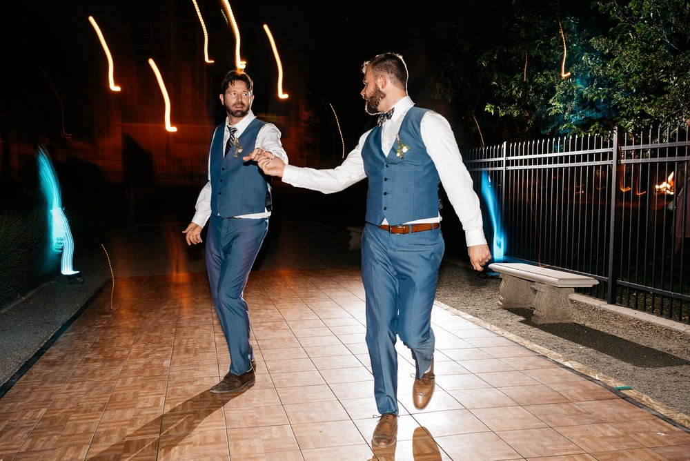 Weston and Karl dance on their wedding night in Denver, Colorado. Wedding photography by Sonja Salzburg of Sonja K Photography.