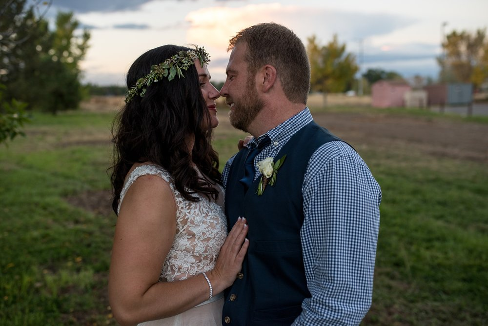 Chris and Julie at sunset on their wedding day in Fort Collins, Colorado. Wedding photography by Sonja Salzburg of Sonja K Photography.