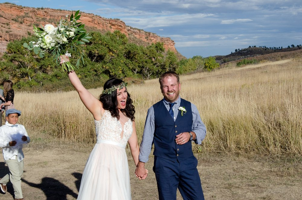 Chris and Julie are married on a warm summer day at Soldier Canyon in Lory State Park outside Fort Collins, Colorado. Wedding photography by Sonja Salzburg of Sonja K Photography.