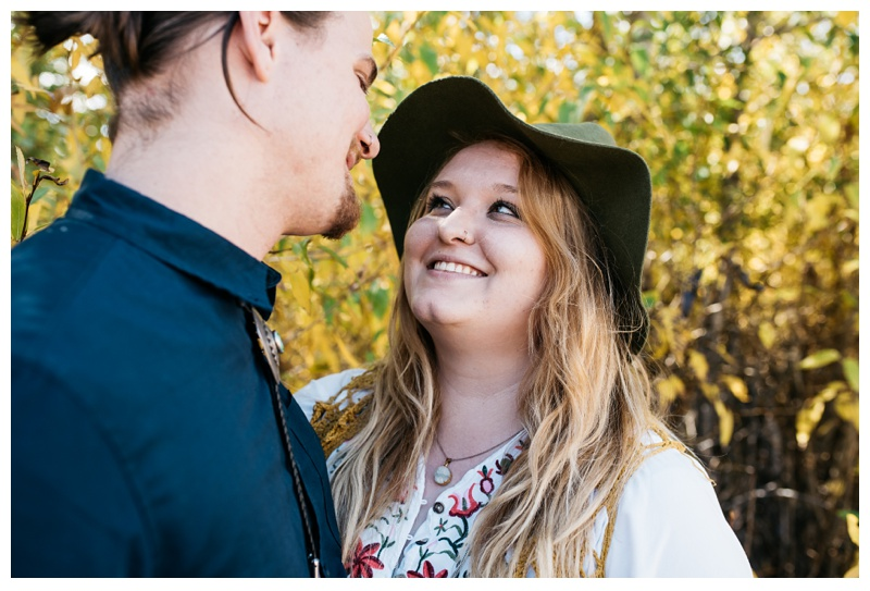 Stephanie looks lovingly at Daniel in Rocky Mountain National Park in Colorado. Engagement photography by Sonja Salzburg of Sonja K Photography.
