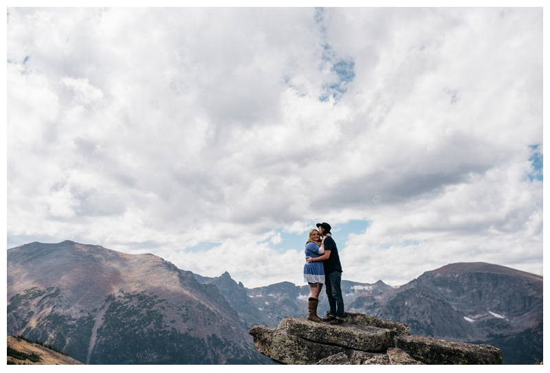 Stephanie and Daniel on a rock in Rocky Mountain National Park in Colorado. Engagement photography by Sonja Salzburg of Sonja K Photography.