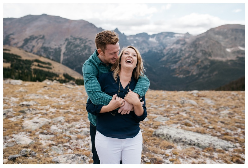 Michael and Miranda share a funny moment in Rocky Mountain National Park in Colorado. Engagement photography by Sonja Salzburg of Sonja K Photography.