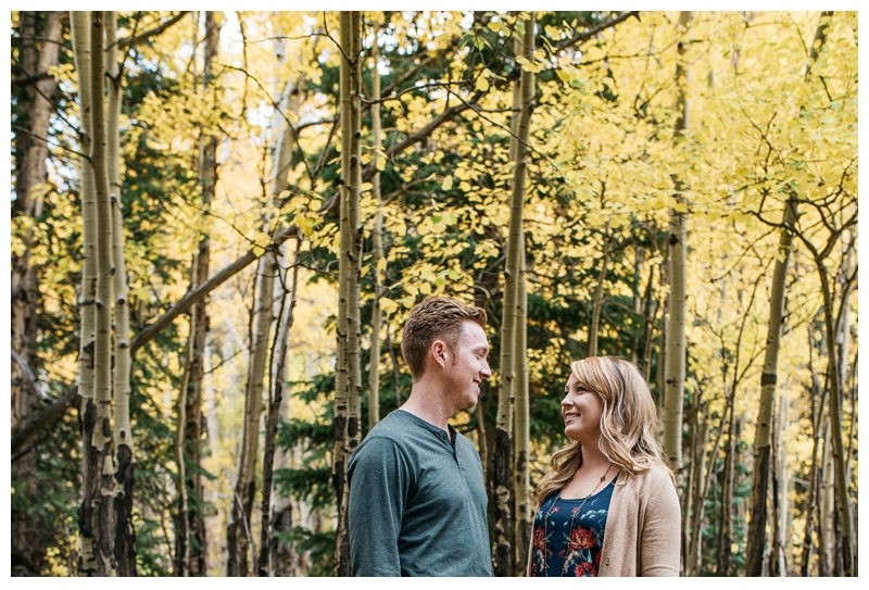 Michael and Miranda in a grove of aspen trees in Rocky Mountain National Park. Engagement photography by Sonja Salzburg of Sonja K Photography.