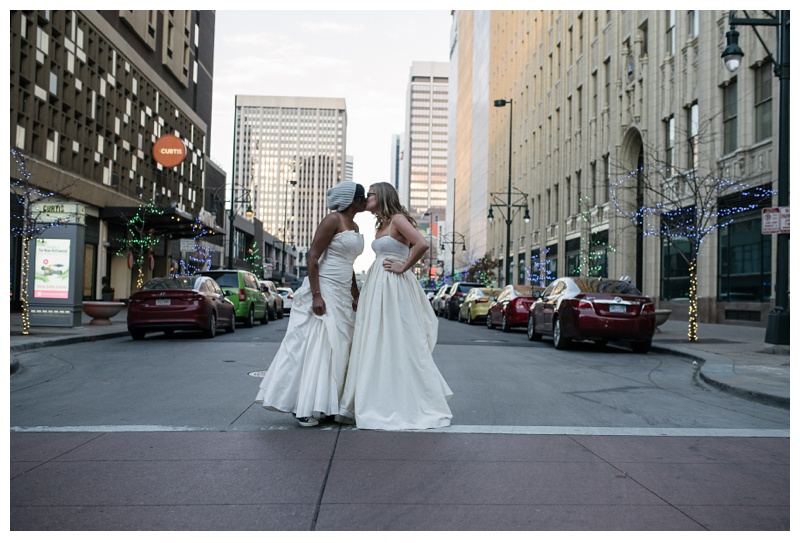 Kinya and Ali in downtown Denver, Colorado on their wedding day. Wedding photography by Sonja Salzburg of Sonja K Photography.