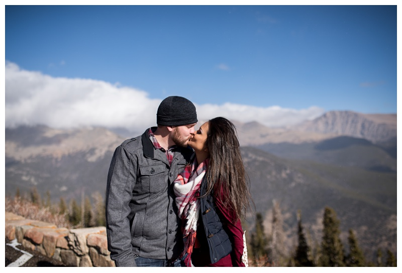 An engaged couple along Trail Ridge Road in Rocky Mountain National Park in Colorado. Engagement photography by Sonja Salzburg of Sonja K Photography.