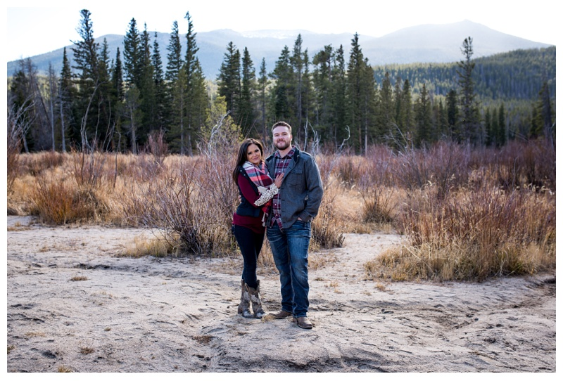 An engaged couple in Rocky Mountain National Park in Colorado. Engagement photography by Sonja Salzburg of Sonja K Photography.