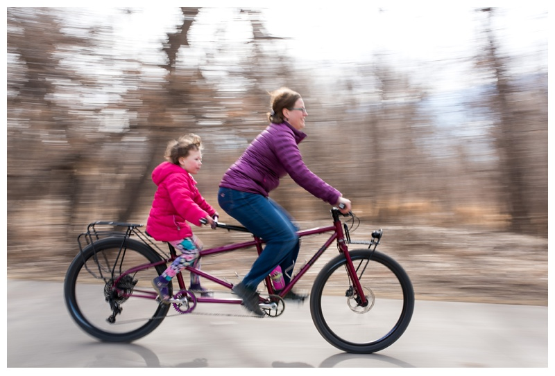 A mother and her daughter ride a new Kelpie Cycles tandem bicycle. Family portrait photography by Sonja Salzburg of Sonja K Photography.