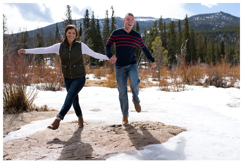 A happy and engaged couple in Rocky Mountain National Park in Colorado. Engagement photography by Sonja Salzburg of Sonja K Photography.