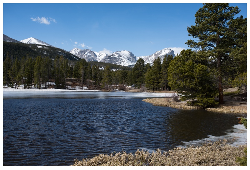 Sprague Lake in Rocky Mountain National Park in Colorado. Wedding engagement photography by Sonja Salzburg of Sonja K Photography.