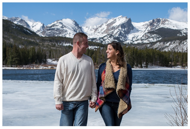 A newly engaged couple at Sprague Lark in Rocky Mountain National Park in Colorado. Engagement photography by Sonja Salzburg of Sonja K Photography.