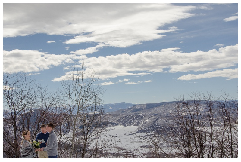 An outdoor winter wedding ceremony at Rabbit Ears Pass outside of Steamboat Springs, Colorado. Wedding photography by Sonja and Max Salzburg of Sonja K Photography.