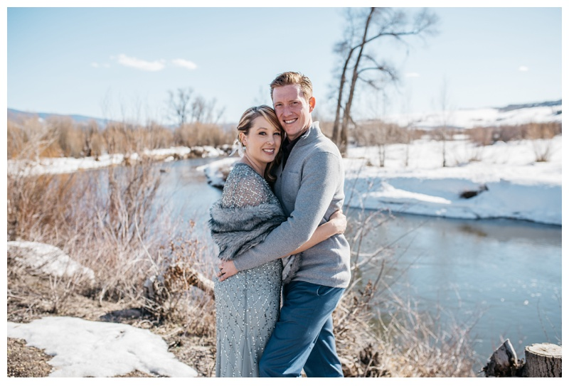 A married couple on the banks of the Yampa River outside of Steamboat Springs, Colorado. Wedding photography by Sonja Salzburg of Sonja K Photography.
