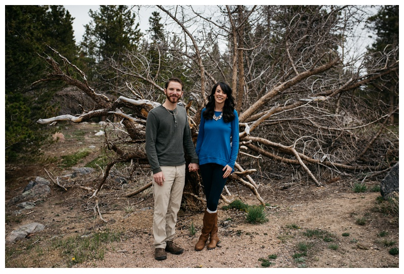 An engaged couple in Rocky Mountain National Park on a spring day. Wedding engagement photography by Sonja Salzburg of Sonja K Photography.