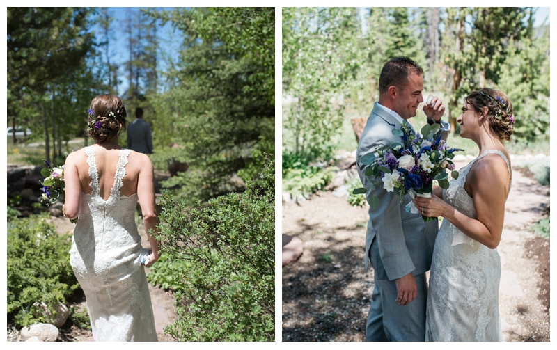 A bride and groom at their first look at a wedding at Wild Horse Inn outside of Winter Park, Colorado. Wedding photography by Sonja Salzburg of Sonja K Photography.
