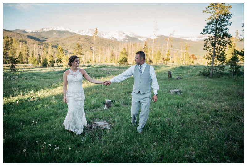 A bride and groom on their wedding day in the Colorado mountains at Wild Horse Inn near Winter Park. Wedding photography by Sonja Salzburg of Sonja K Photography.