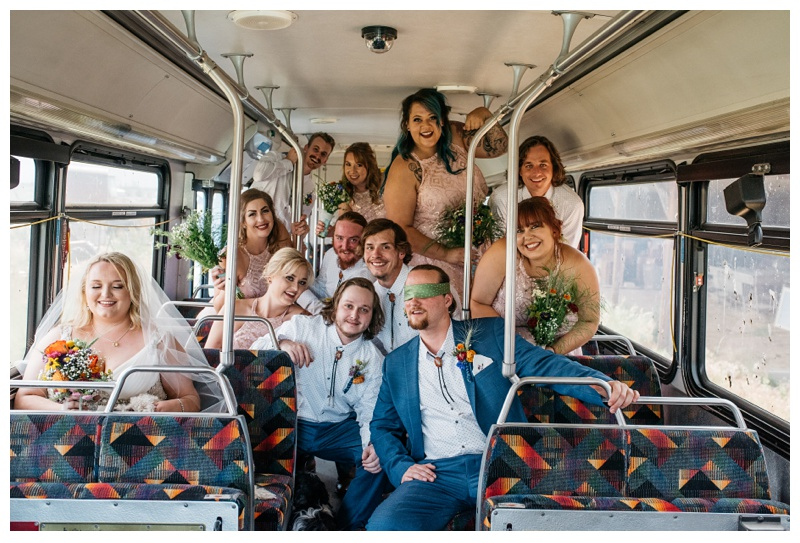 The wedding party on a bus, at a farm near Platteville, Colorado. Wedding photography by Sonja Salzburg of Sonja K Photography.