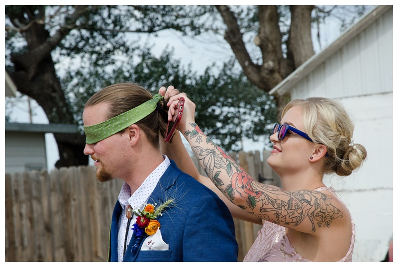 "The groom is blindfolded in preparation for a ""blind first look"" on his wedding day at a farm near Platteville, Colorado. Wedding photography by Sonja Salzburg of Sonja K Photography."