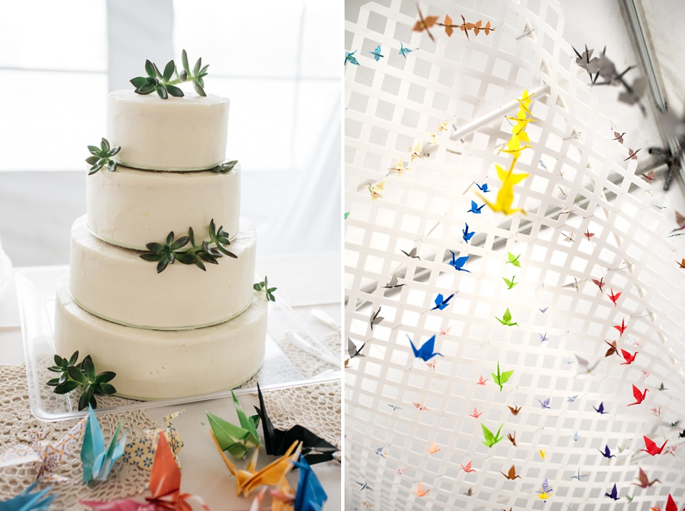 The cake and folded cranes at a wedding near Curt Gowdy State Park and Vedauwoo outside of Cheyenne and Laramie, Wyoming. Wedding photography by Sonja Salzburg of Sonja K Photography.