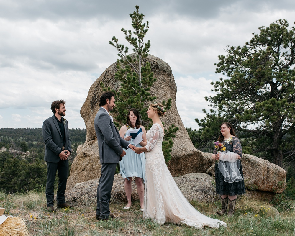 A wedding ceremony near Curt Gowdy State Park and Vedauwoo near Cheyenne and Laramie, Wyoming. Wedding photography by Sonja Salzburg of Sonja K Photography.