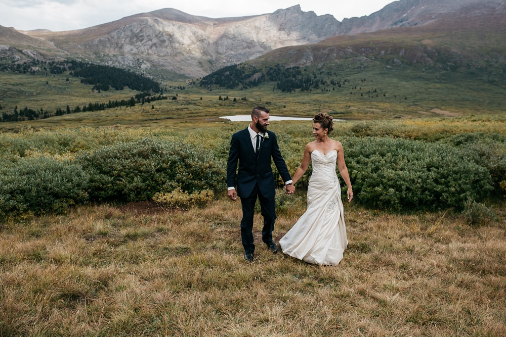 A bride and groom at their first look near Guanella Pass in Colorado. Outdoor wedding photography by Sonja Salzburg of Sonja K Photography.