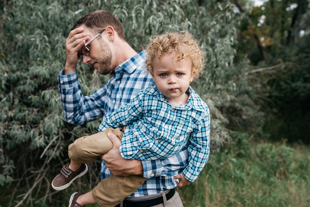 A young father and his son on a warm fall day at Lee Martinez Park in Fort Collins, Colorado. Family portrait photography by Sonja Salzburg of Sonja K Photography.