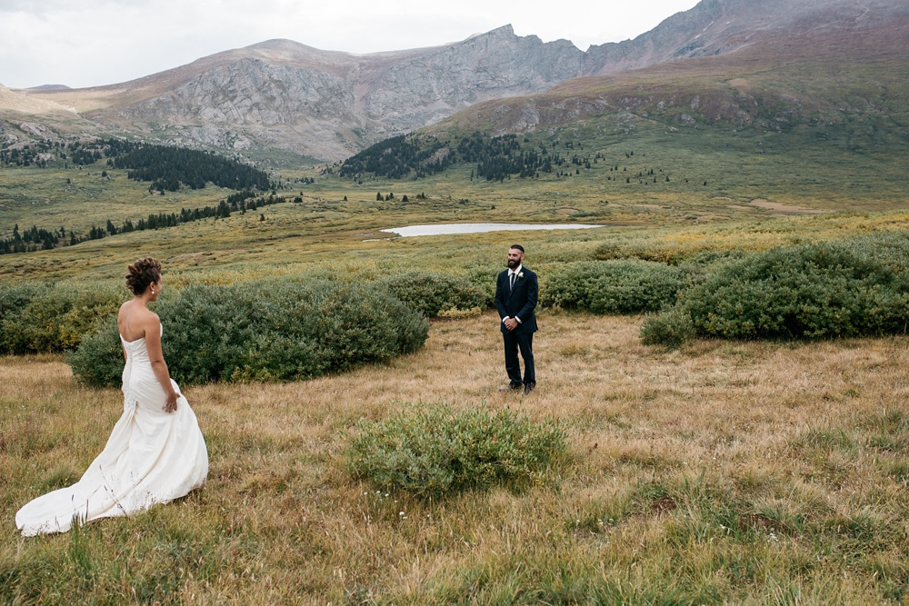 A beautiful first look near Guanella Pass in Colorado. Wedding photography by Sonja Salzburg of Sonja K Photography.