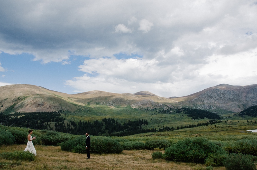 A beautiful first look at Guanella Pass in Colorado. Outdoor wedding photography by Sonja Salzburg of Sonja K Photography.
