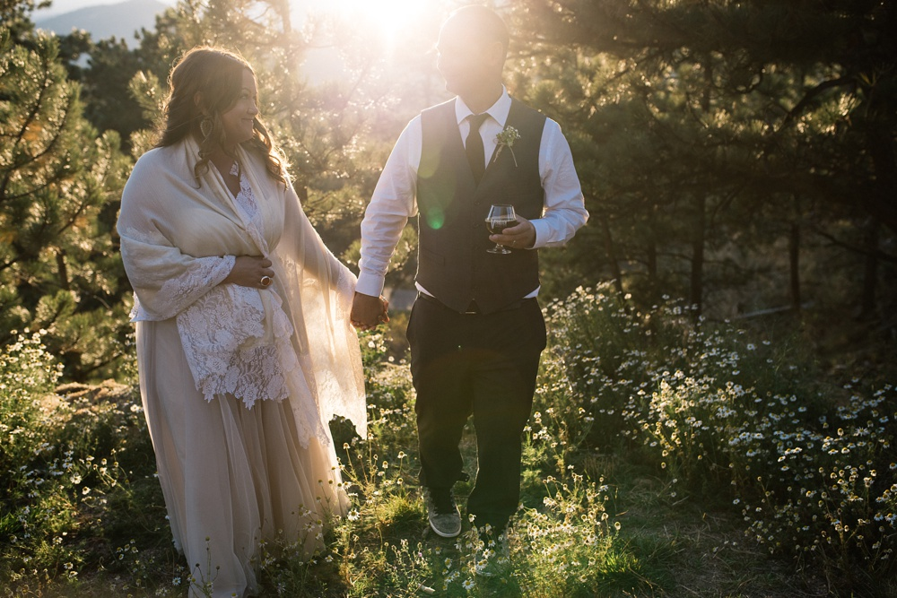 A beautiful couple on their outdoor wedding day at the Historic Crags Lodge in Estes Park, Colorado. Wedding photography by Sonja Salzburg of Sonja K Photography.