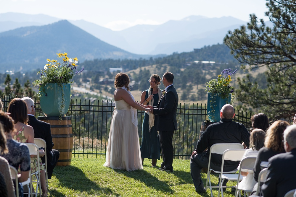 A bight sunny outdoor wedding ceremony at the Historic Crags Lodge in Estes Park, Colorado. Wedding photography by Sonja Salzburg of Sonja K Photography.