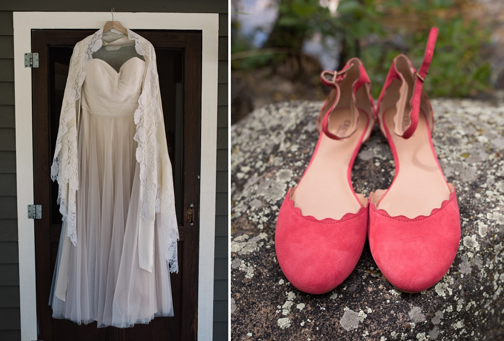 A wedding dress and shoes at a wedding at the Historic Crags Lodge in Estes Park, Colorado. Wedding photography by Sonja Salzburg of Sonja K Photography.