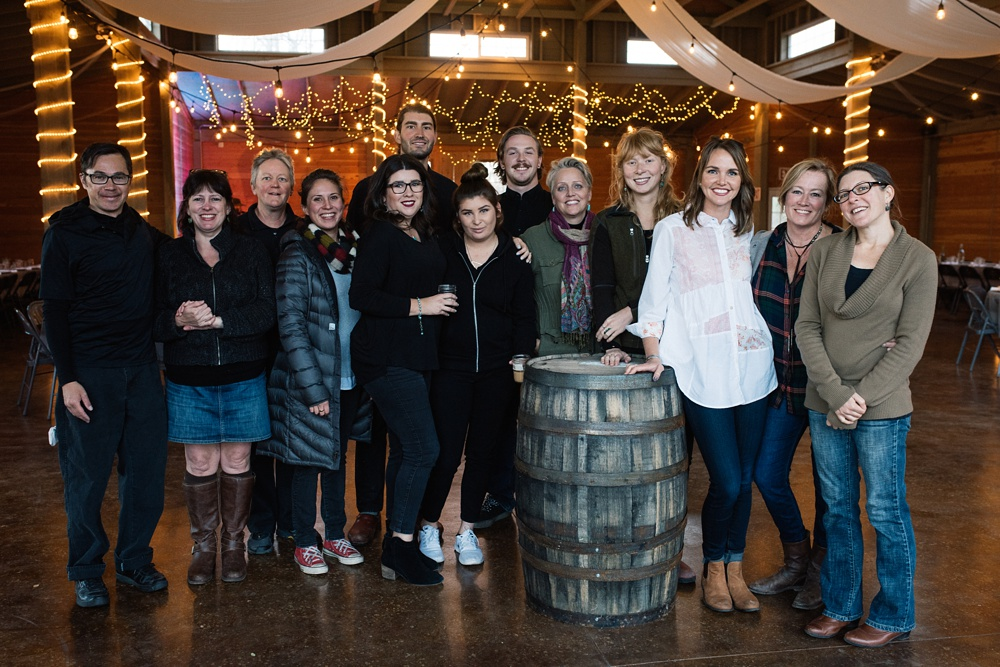 The volunteer staff and the staff of Fortified Collaborations at the Mad Farmer Dinner at Hope Farms in Fort Collins, Colorado. Event photography by Sonja Salzburg of Sonja K Photography.