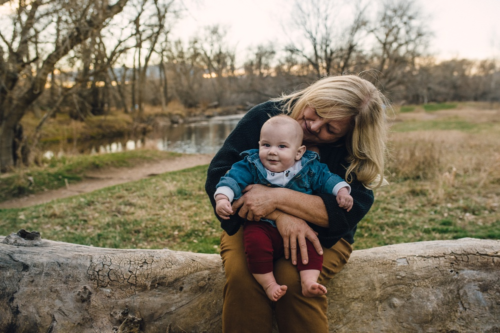 A grandmother with her grandchild on a warm late fall evening at Legacy Park in Fort Collins, Colorado. Family portrait photography by Sonja Salzburg of Sonja K Photography.