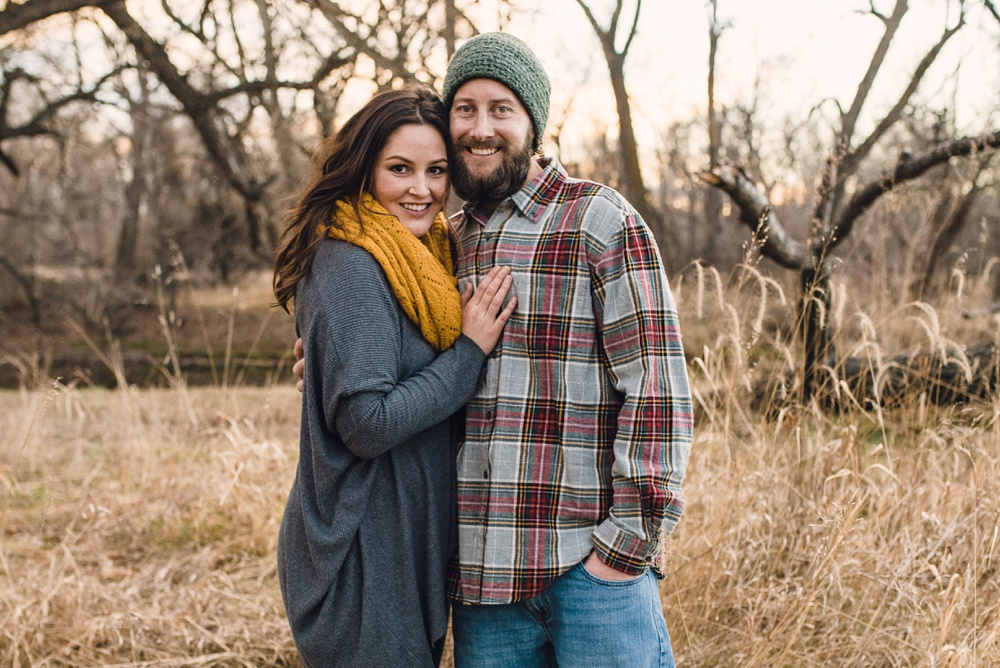 A young couple on a warm late fall evening at Legacy Park in Fort Collins, Colorado. Family portrait photography by Sonja Salzburg of Sonja K Photography.