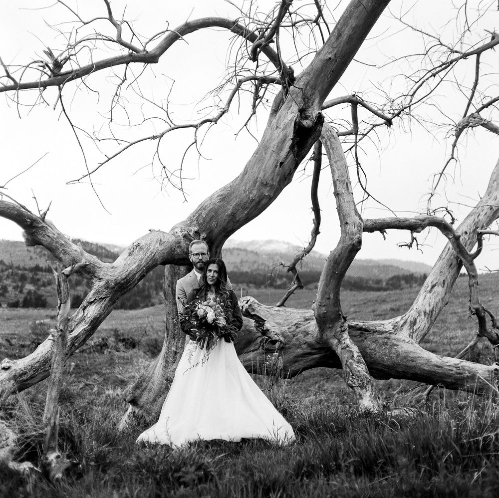 A bride and groom in black and white at Lory State Park outside of Fort Collins, Colorado. Black and white wedding photography by Sonja Salzburg of Sonja K Photography.