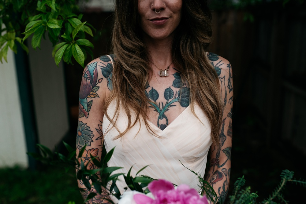 A tattooed bride on her wedding day in Fort Collins, Colorado. Wedding photography by Sonja Salzburg of Sonja K Photography.