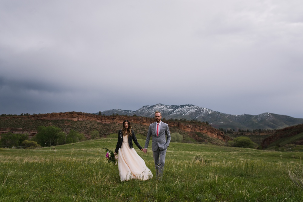 A bride and groom on a chilly fall day at Lory State Park outside of Fort Collins, Colorado. Wedding photography by Sonja Salzburg of Sonja K Photography.