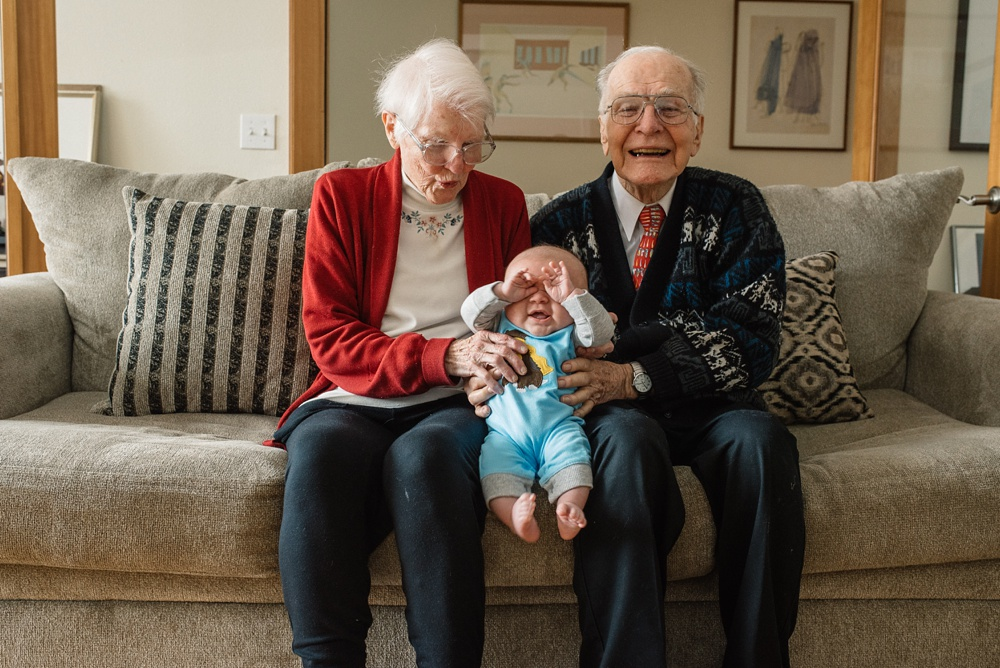 Great-grandparents and their great-grandson at a family session in Fort Collins, Colorado. Family portrait photography by Sonja Salzburg of Sonja K Photography.