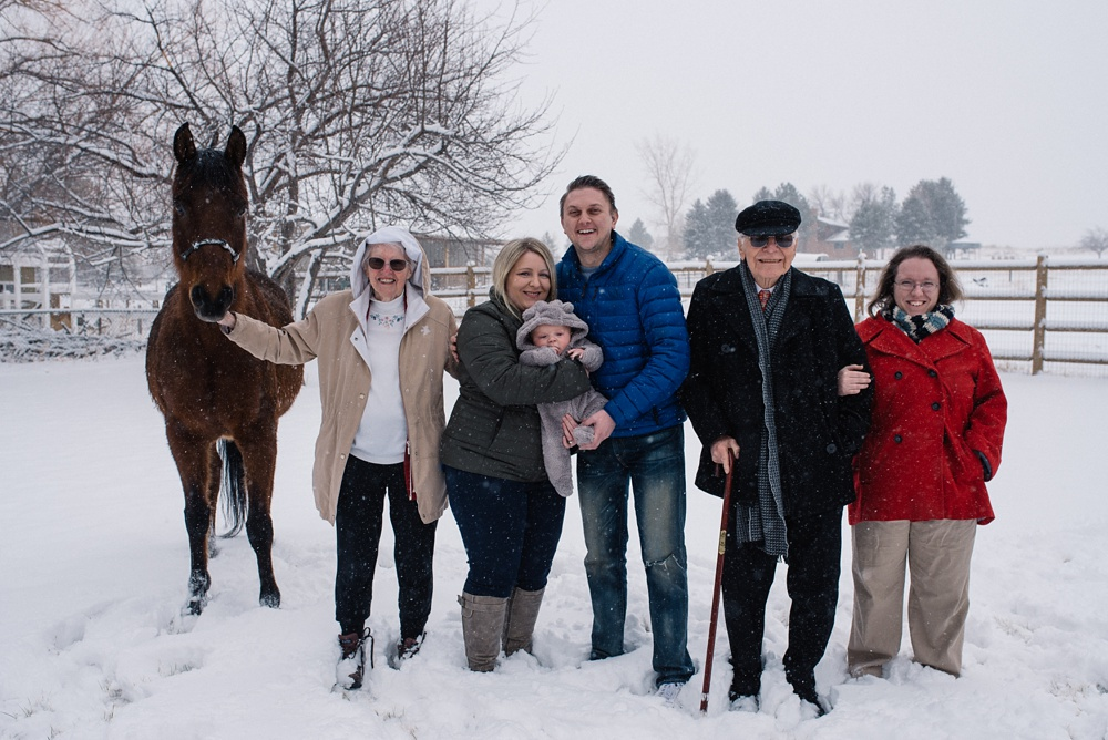 A family and their horse at their property in Fort Collins, Colorado. Family portrait photography by Sonja Salzburg of Sonja K Photography.