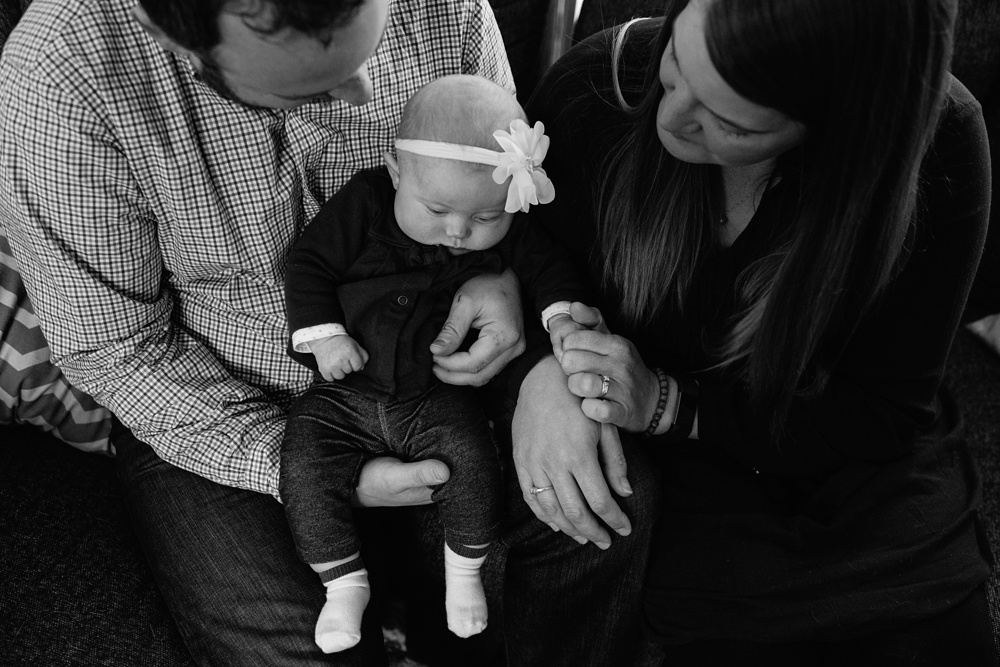 A young family at their home in Fort Collins, Colorado. Family portrait photography by Sonja Salzburg of Sonja K Photography.