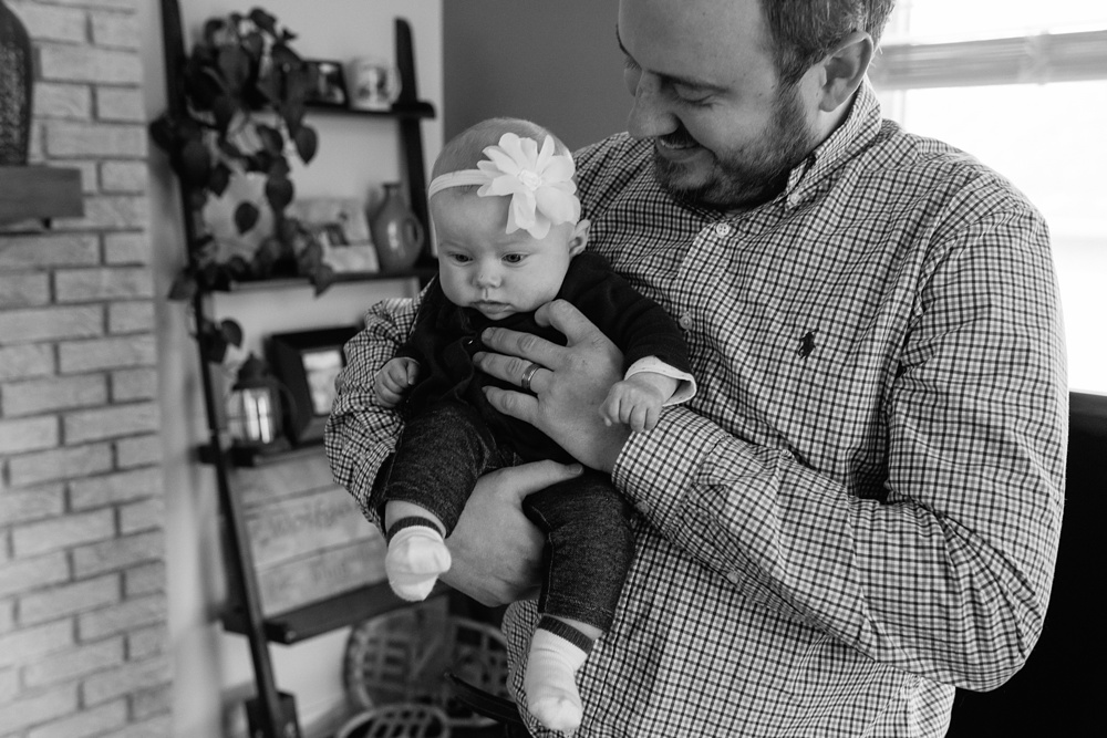 A baby and her father at home in Fort Collins, Colorado. Family portrait photography by Sonja Salzburg of Sonja K Photography.