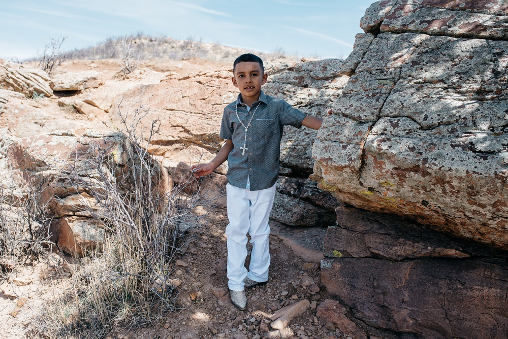 A young boy in the rocks on Duncan Ridge near Horsetooth Reservoir outside of Fort Collins, Colorado. Family portrait photography by Sonja Salzburg of Sonja K Photography.
