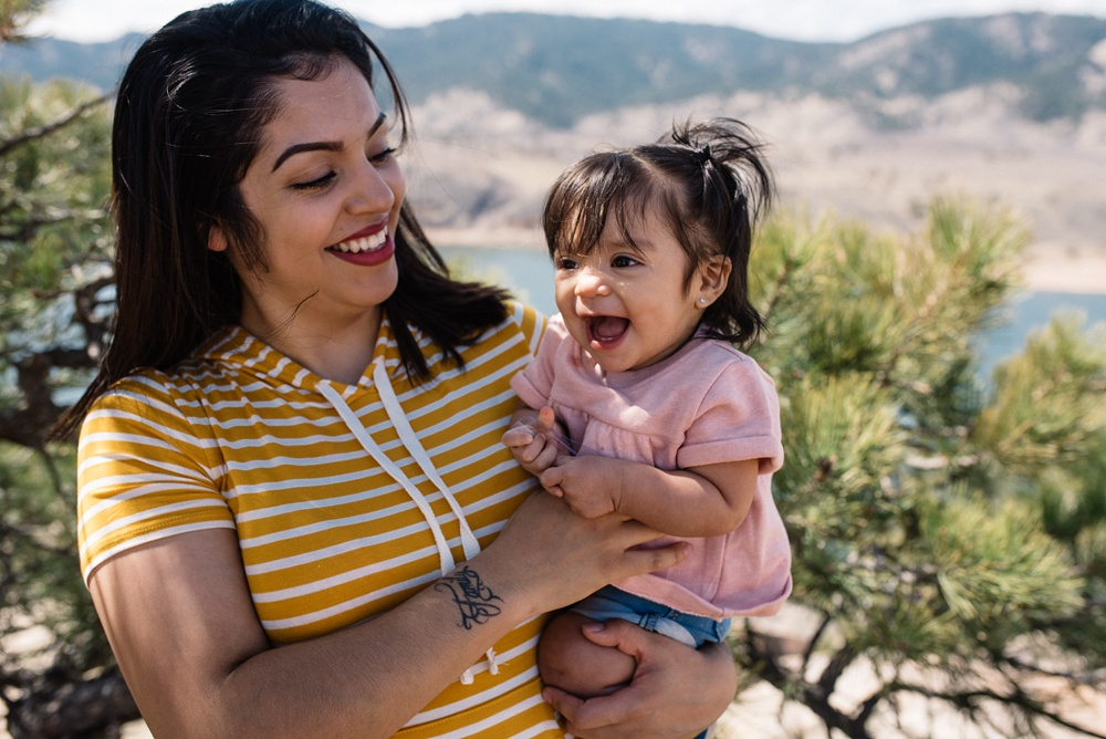 A happy mother and daughter on Duncan Ridge near Horsetooth Reservoir outside of Fort Collins, Colorado. Family portrait photography by Sonja Salzburg of Sonja K Photography.